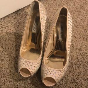 JLo studded peep-toe heels